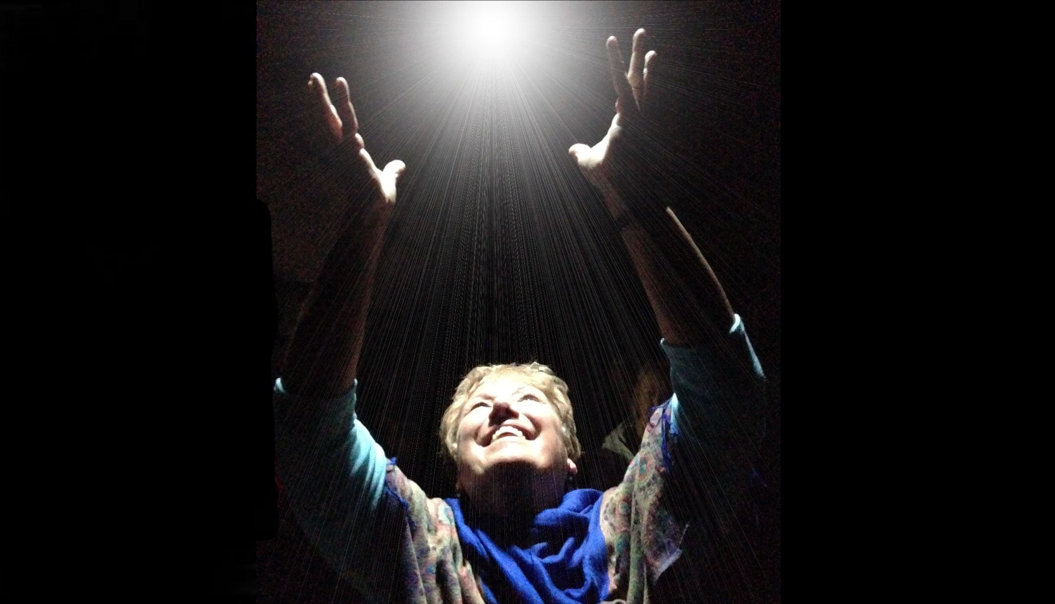 Woman holding a bright white light